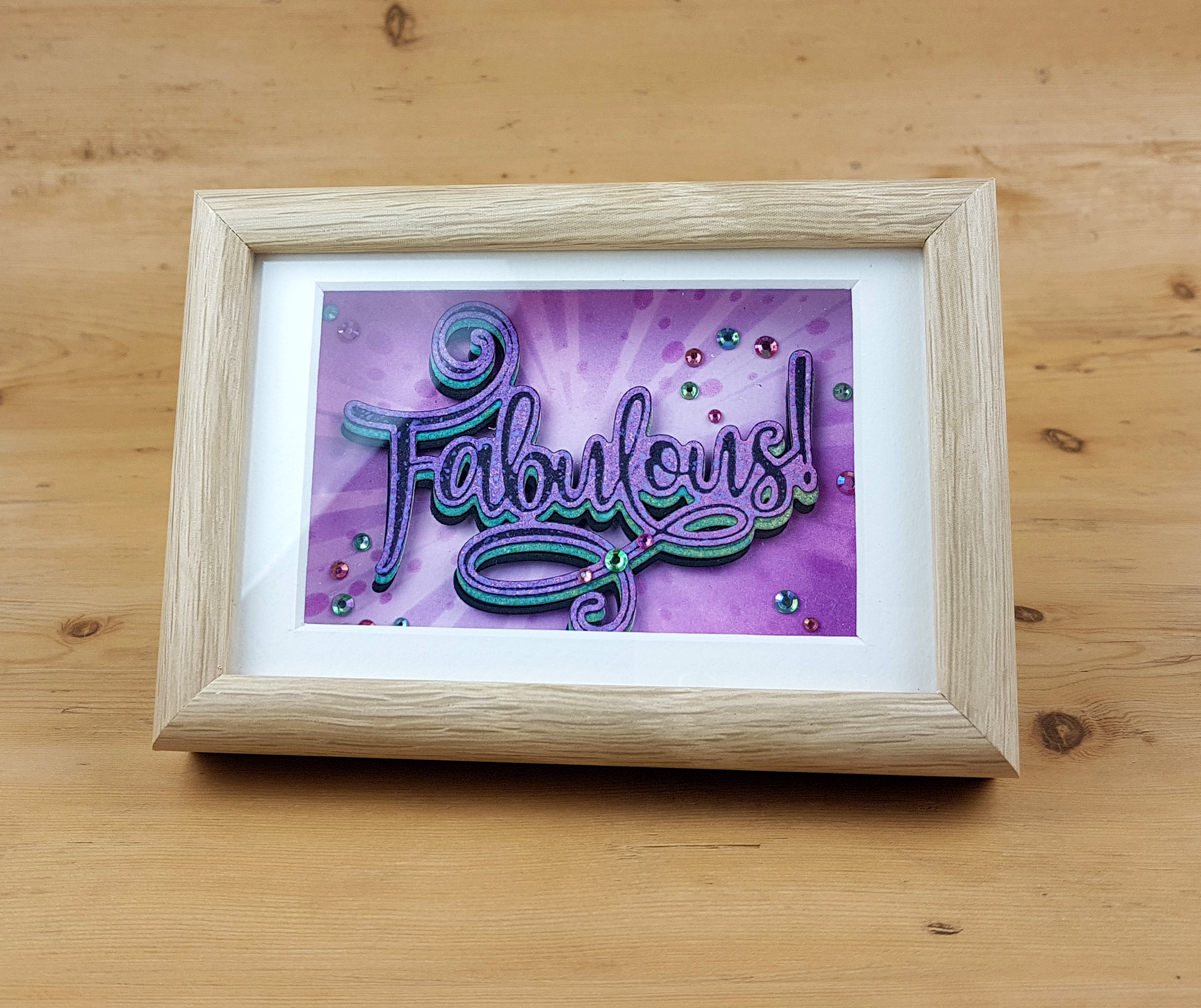 Image showing a framed die cut word. Design by John Bloodworth Gentleman Crafter featuring the Fabulous cut foil and emboss die from Couture Creations